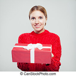 Red gift box with white silky ribbon in female hand