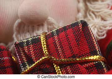 Red gift with gold bow