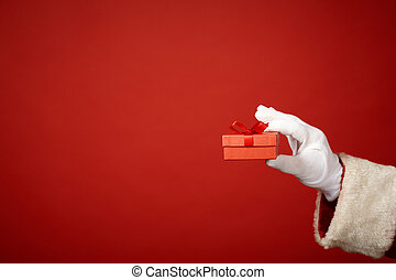 Red giftbox in gloved hand