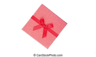 top view of a red gift box with ribbon isolated on white background