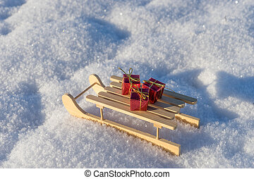 Red gifts on sled in the snow