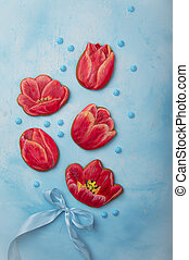 red gingerbread in the form of flowers on a blue background