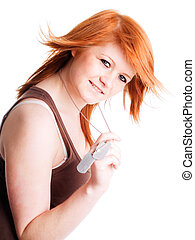 red girl holding dogtags over white background