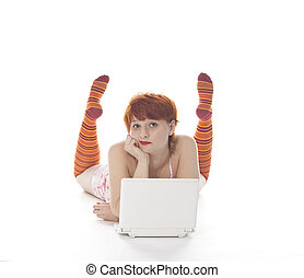 Red Girl in stripe socks with laptop on white background
