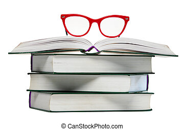 red glasses on open book