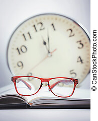 red glasses on the book