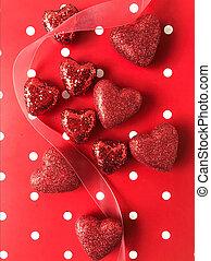 Red glitter hearts on polka dot background