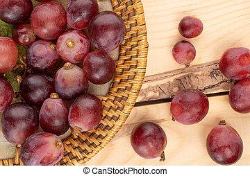 Red globe grape on wood