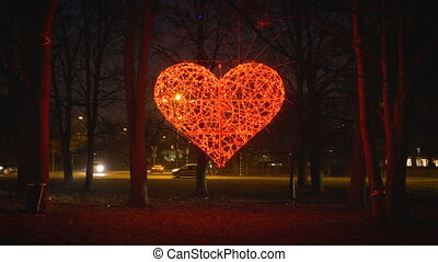 red glowing heart in a roundabout