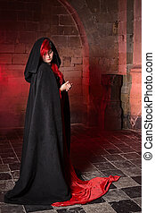 Red gothic witch - Gothic witch woman standing in a medieval...