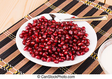 red grains of a pomegranate.