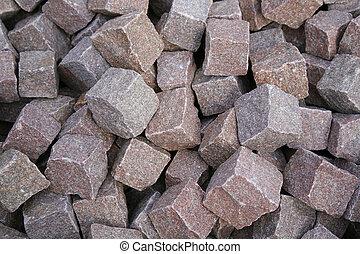 Pile of red granite cobble stone