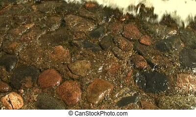 Red granite under water