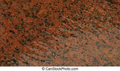 Red granite under water