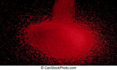 Red Granules Pour Into Pile - Red material pouring into pile