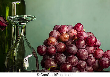 Red grapes and wine glasses