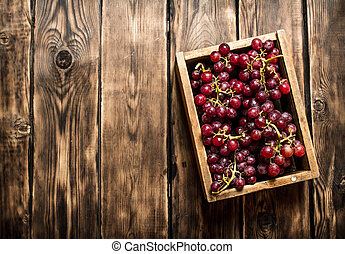Red grapes in an old box.