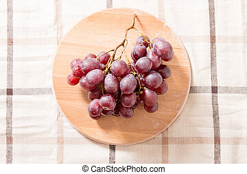 Red Grapes In Wooden Plate