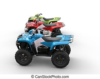 Red, green and blue four wheelers - side view