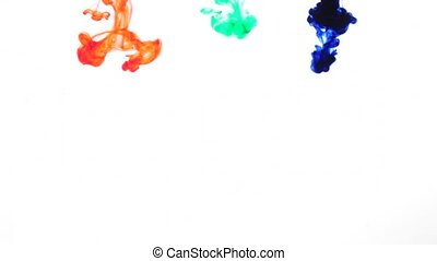 red green and blue ink drops