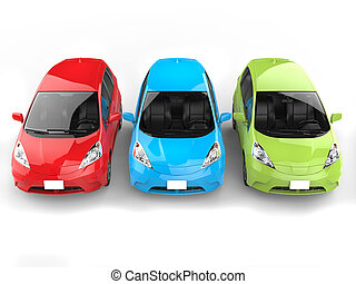 Red, green and blue modern electric cars - top view