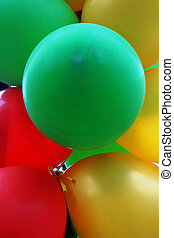 Red, green and gold balloons