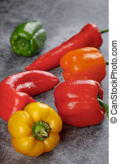 Red, green and yellow sweet bell peppers.