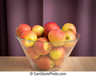 Red green apples in a glass bowl