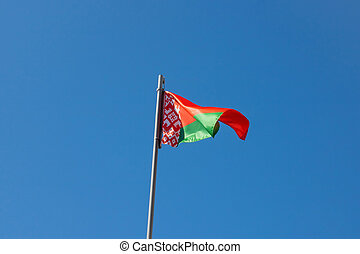 Red green flag of Belarus against the blue sky