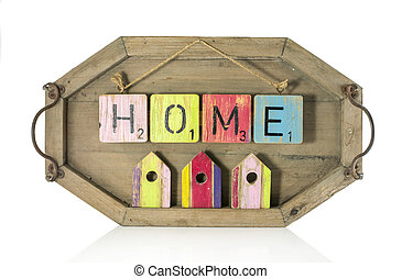 home text and small houses on wooden background