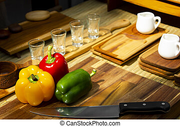 Red, Green , yellow bell pepper on wooden table for cooking in the kitchen.