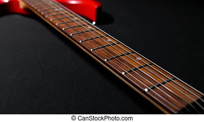 Red Guitar on a Black Background