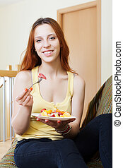 woman with plate of fruits salad