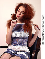 Red hair - Portrait of the girl with red hair in a blue...