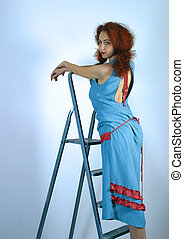 Red hair - Portrait of the girl with red hair in a dark blue...