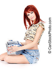 Red hair teenage girl holding CD player, isolated on white...