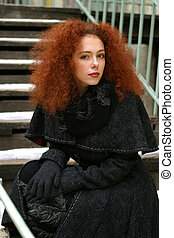 Red hair - The beautiful girl in a black coat