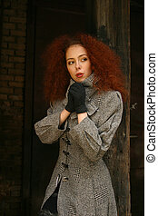 Red hair - The beautiful girl in a grey coat