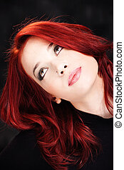 Red hair woman looking up