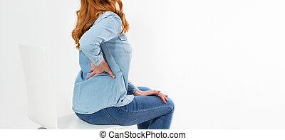 red hair Woman with back pain isolated on white