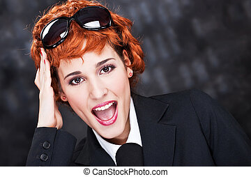 Red hair woman with big sun glasses