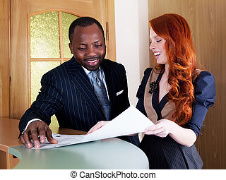 Red hair young businesswoman and black american businessman...