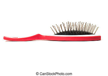 Red hairbrush on a white background, isolated