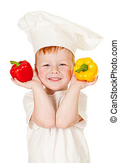 red-haired boy in cook hat with vegetables isolated on white