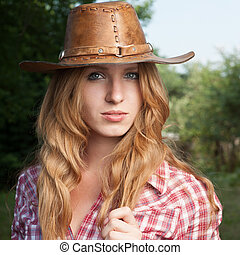 red haired cowgirl - outdoors portrait of beautiful red ...