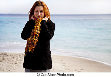 Red-haired girl at the beach.