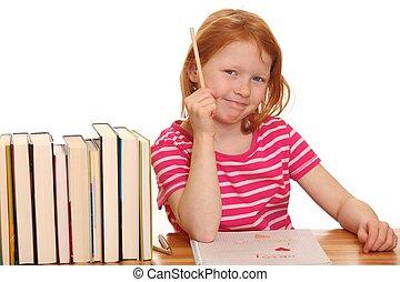 Red haired girl doing her homework