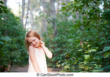 Red-haired girl in a beautiful dress