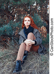 red-haired girl in autumn trendy clothes