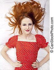 Red-haired girl in dress.